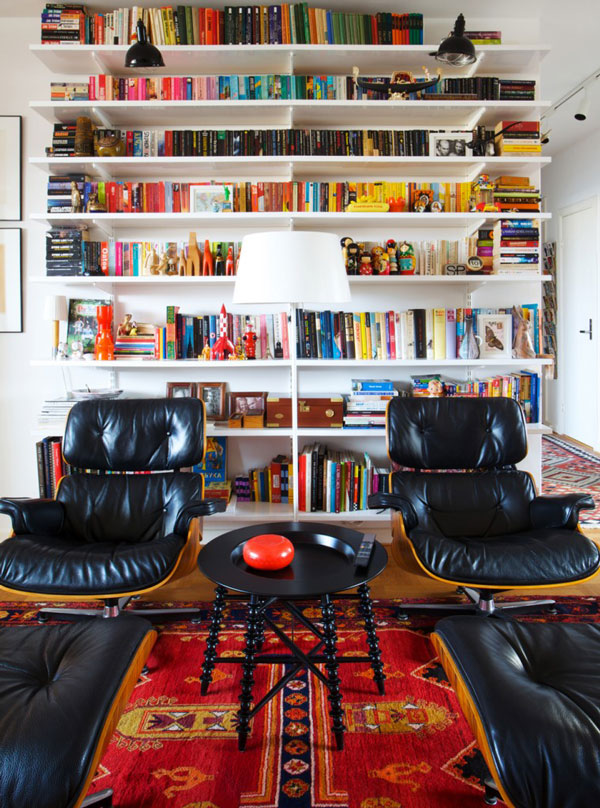 Eames-lounge-chairs-and-colorful-bookshelf-display-760x1024