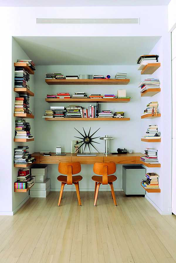 The shelves in the office space are custom made perfectly matching the two Eames chairs below.